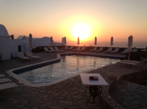 The sun sets over the pool in Santorini. I love swimming small but effective laps here first thing in the morning